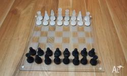 Glass chess set for sale. All pieces have been stored
