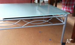 Glass coffe table with metal legs. Glass separates for