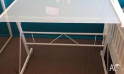This glass desk is used, but in excellent condition. I