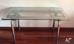 Very nice glass table with 2 extentions. Inox legs and