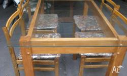 Glass top table and 4 chairs, table base pine, chairs