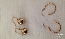 Gold twisted earrings can't see a mark but they are