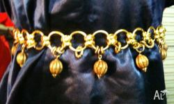 An assortment of elegant Gold Link Belts Priced as