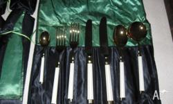 Gold plated cutlery set (seven pieces in the set) .