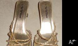 Never worn but very fashionable. Ladies pair of gold