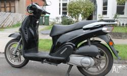 Selling my much loved black Mojo scooter with rego up