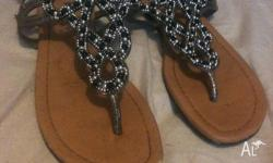 Great pair of sandals with beads on the top of shoe.