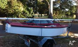 Small fibre glass hull sailing boat. Great to learn on