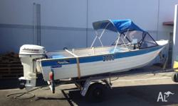 This is a 15 foot runabout with canopy that has served
