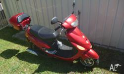 Red Zoot scooter, 50cc. Low km, in great condition. New