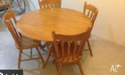 Solid wood table Four chairs in great condition