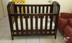 Grotime walnut cot in good condition, adjustable base
