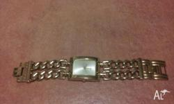 Gold guess watch in perfect condition. Still has the