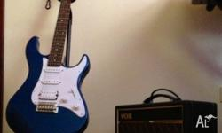 Yamaha Pacifica Guitar (navy) and a VOX amp are