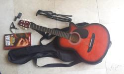 Beginer's guitar for sale - with all accessories shown