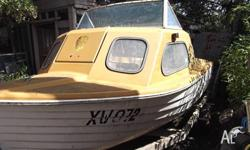 Half-cabin Stylecraft 15 foot fibreglass runabout needs