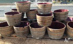 Freshly emptied barrels cut to halves for pots, ideal