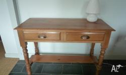 Smart hall table with two brass-handled drawers. Some