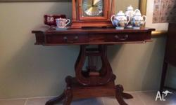 Magnificent timber hall table. Has 2 drawers. Brass