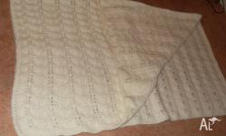 Beautiful hand knitted woollen baby blankets, cot