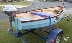 Hand made clinker style wooden dinghy. 2 hp. Honda 4