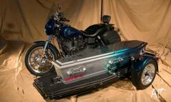 Harley Davidson FXDXT with Premier flat bed. One owner
