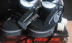 Genuine Heelys Skate shoes. Worn once but too small.