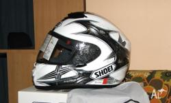 Brand new helmet never worn plastic still on visor,