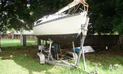 Fibreglass Yacht with fixed keel plus tender on beach