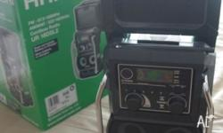NEVER USED RADIO Includes: 1 x AC Adapter (DC 12V 850