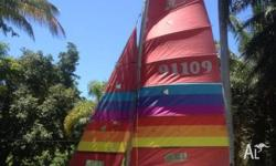 Hobie 16 , Two sets sails with some damage. Rigged with