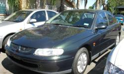 HOLDEN,COMMODORE,VT,1998, RWD, Green, Grey trim, 4D
