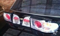 VR/VS Commodore clear tail lights, in ok condition one