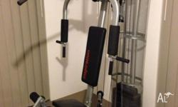 A home gym set in good condition. The cables need to be