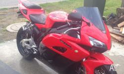 Red 2004 CBR1000rr in fantastic condition with 12