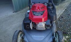 Honda mower in as new condition, comes with mulch plug,