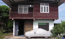 This older typical Thai house is located right on the
