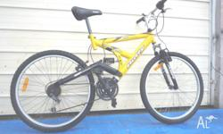 Yellow Huffy Heliax DST Bike. 21 Speed with a good