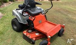 2011 Mower, Has open deck with side discharge, or