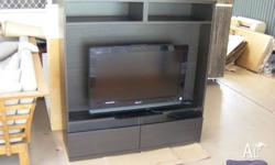 Black/brown Ikea TV unit with with a flat screen 27'""