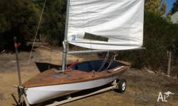 Timber Impulse dinghy for sale. Dry hull. Top varnish