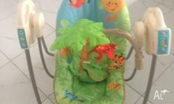 Fisher Price Rainforest battery operated swing.