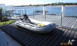 as new used twice inflatable with 3.6 h.p. parson