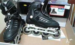 Pair of Inline skates and knee, wrist and elbow