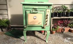 This Simpson porcelain green stove and oven has been