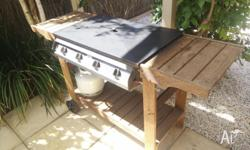 Listed is a Jackaroo J4J 4-burner BBQ in good working