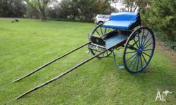 Jinker with 48 inch steel wheels with rubber tyres on