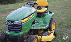 John Deere X320 22hp V twin motor. Select series with