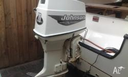 70 hp Johnson outboard motor 2stroke oilinjected . Tilt