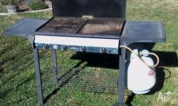 Jumbuck 4-Burner gas BBQ in good condition. Includes: -